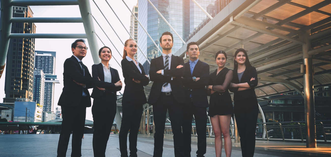 Young professionals outside buildings and skyscrapers