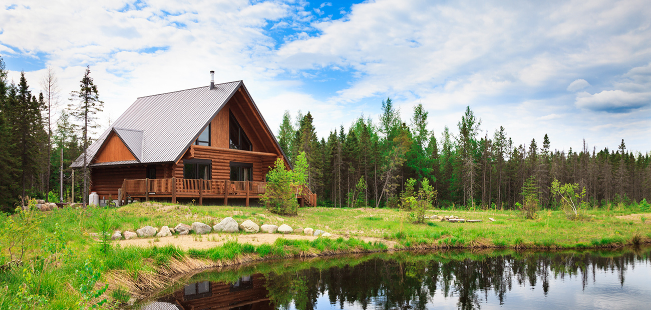 A-Frame log cabin by a lake