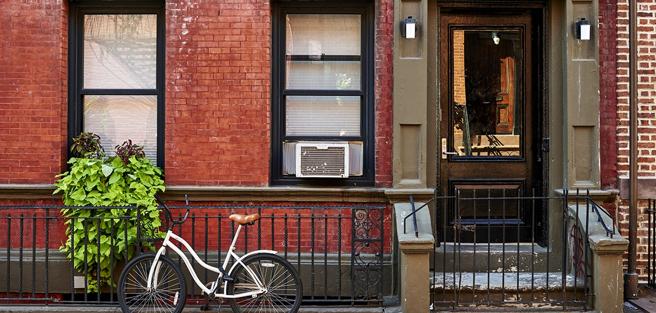 Bicycle outside a brownstone house