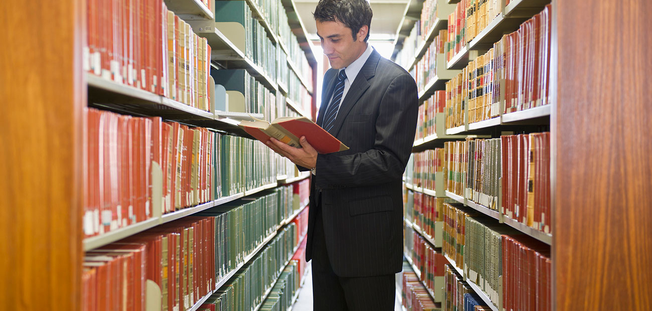 Businessman Doing Research in Library