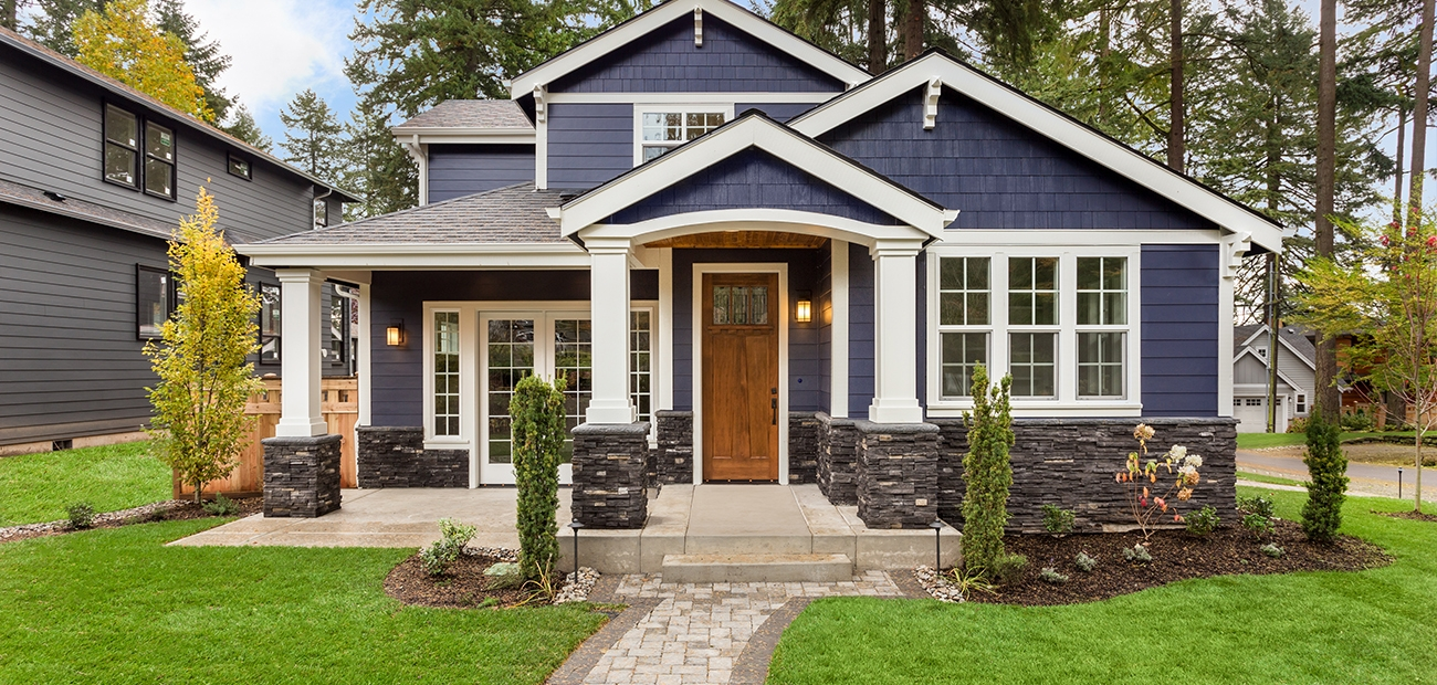 Dark gray house with white trim