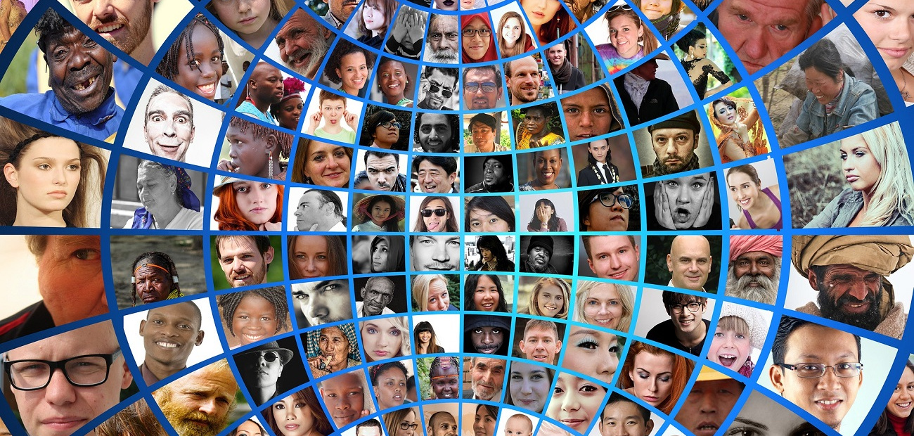 A montage showing a world globe featuring faces from all over the world