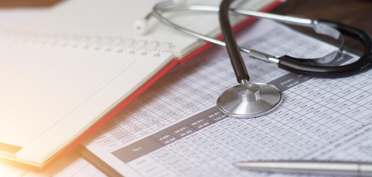 Stethoscope on medical billing documents