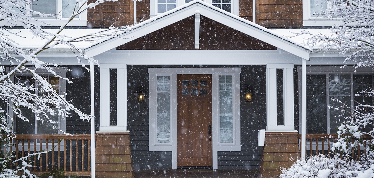 House with porch on snowy day