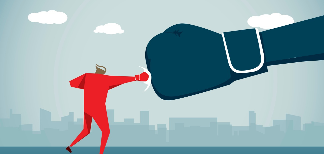 Illustration of a man punching a large boxing glove
