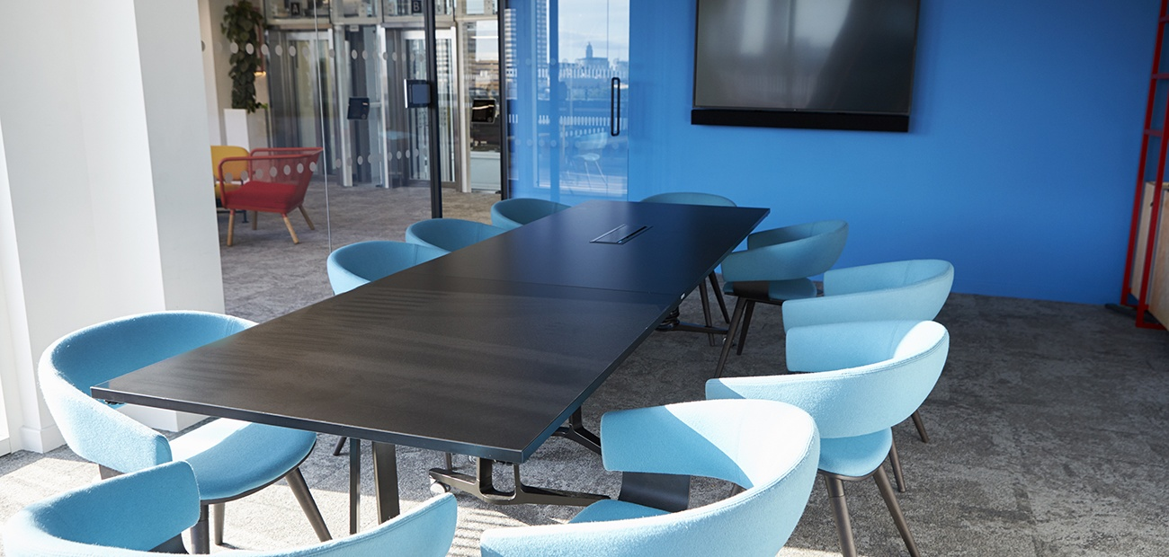 Meeting room with a table and blue chairs