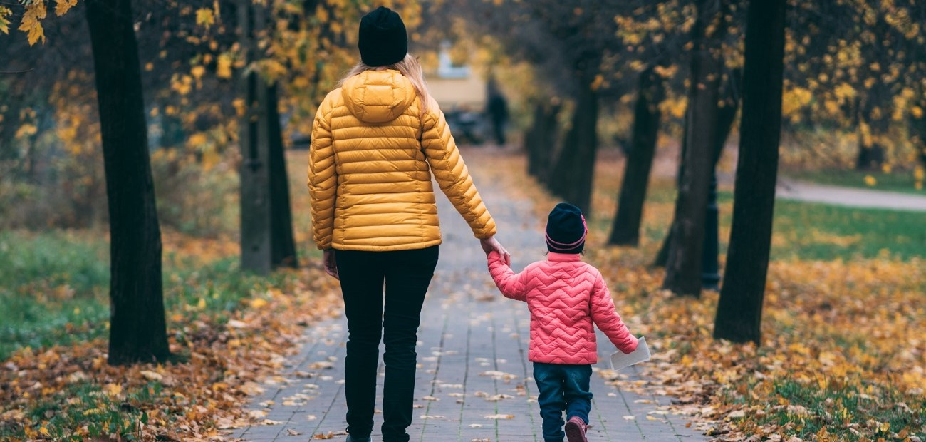Mother and daughter walking in a park