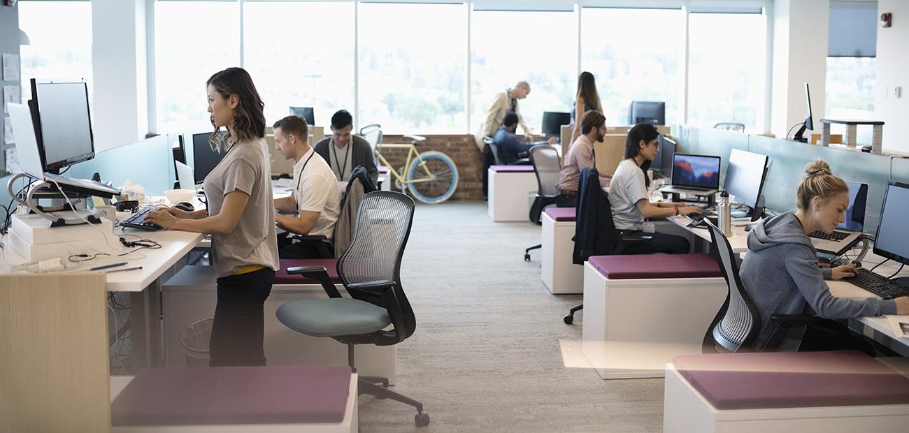 People working in an open office plan
