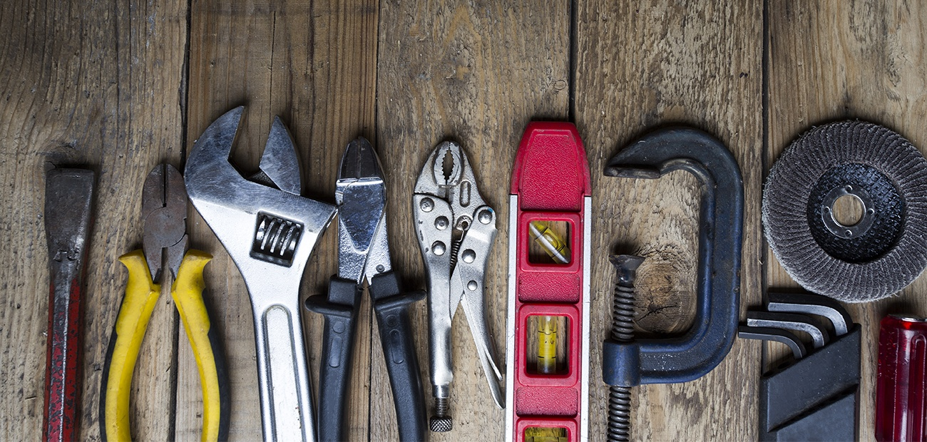 A set of tools on an old wooden surface