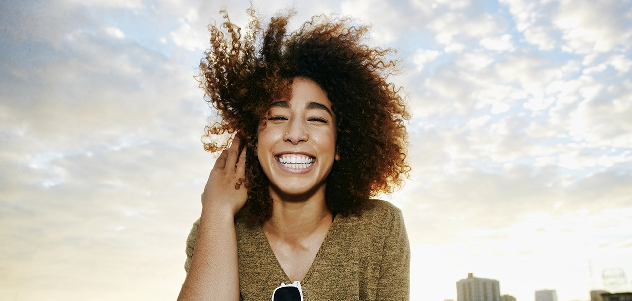 Smiling young woman on a rooftop