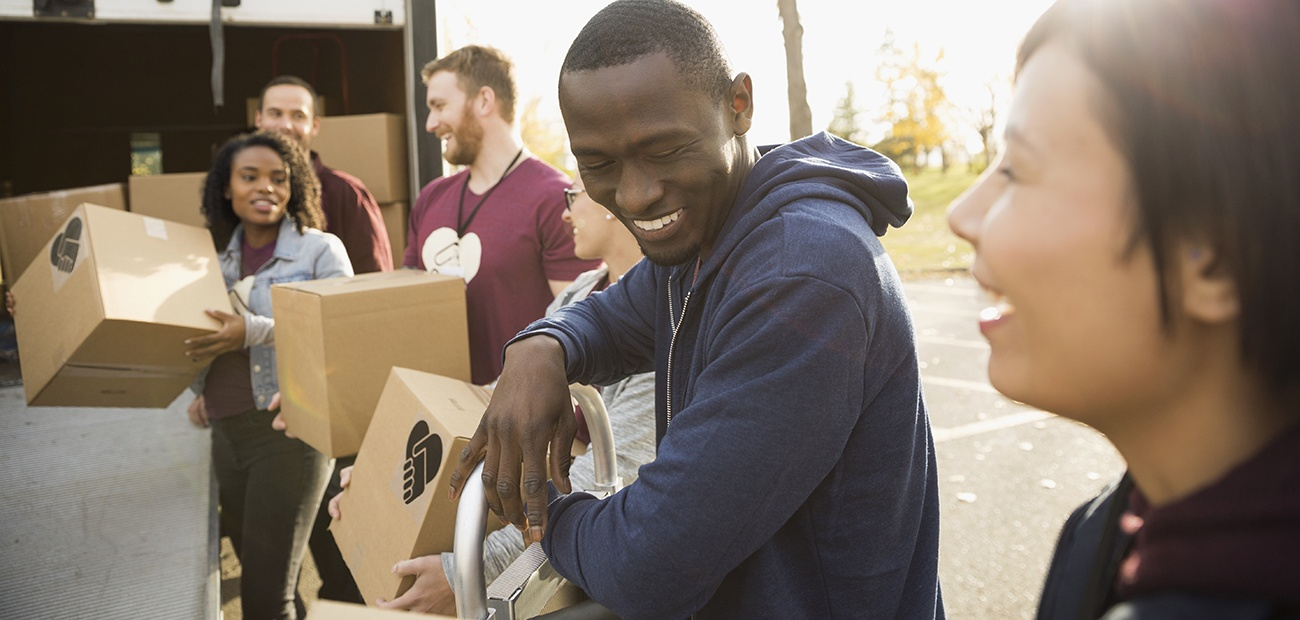 Volunteers unloading boxes from a van