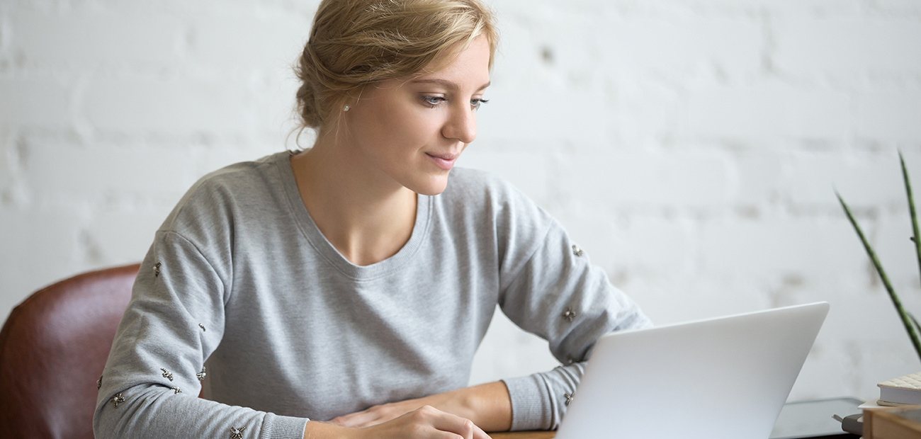 Woman studying at computer