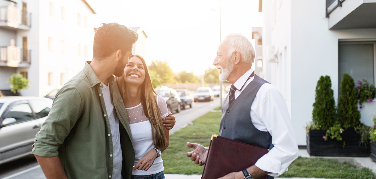 Young Couple Talking w Real Estate Agent Buying New House