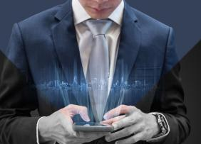 Man in suit and tie with mobile phone - technology concept