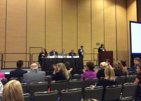 Leadership-Board Forum-Wrap-up with panel on stage.