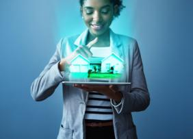 businesswoman using a digital tablet with property graphics