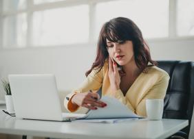 Woman on phone with laptop