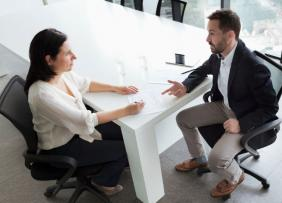 Man and woman in a conference room for an interview