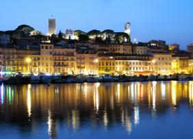 Panorama of Cannes, at dusk. French Riviera.
