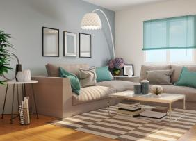 a gray living room witth teal accents