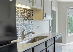 An intricate black and white tile backsplash.