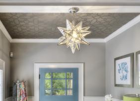 An entryway with a patterned ceiling