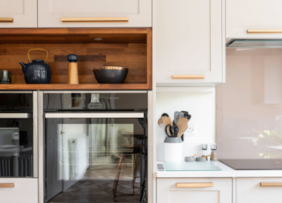A white cabinet kitchen with rose gold cabinet hardware