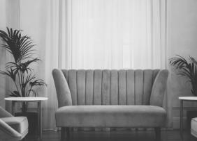 Gray scale image of a couch in a living room