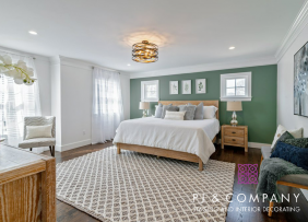 Bedroom with green accent wall staged by Patti Stern