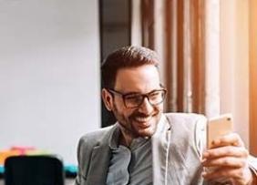 Sprint Customer Smiling at Smartphone