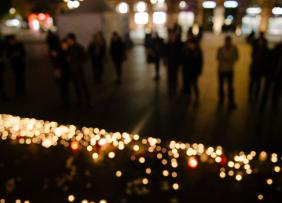 People near mourning candles