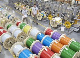 Colorful spools of optic cables in a factory