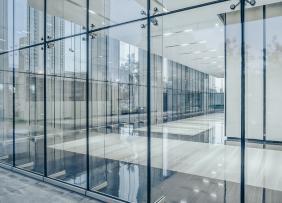 Commercial building corridor seen through glass walls