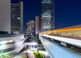 Commercial office buildings and commuter train at night
