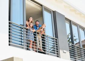 Condo - Family of Four on Balcony
