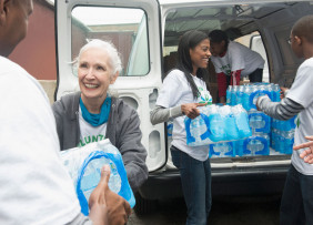 Disaster Relief Volunteers Passing Out Water