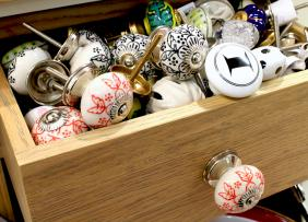 Drawer full of colorful cabinet knobs