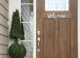 Front door with welcome sign