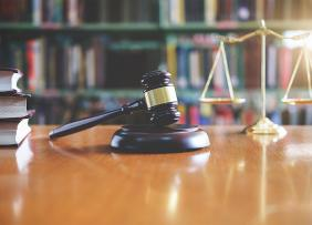 Gavel, scales, and books on a table