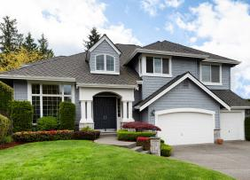 Gray house with two-car garage and landscaping