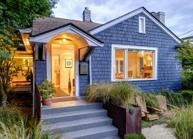 Illuminated blue shingled house