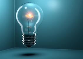 Innovation Summit - Light Bulb on Blue Background