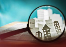 Magnifying glass and newspaper houses