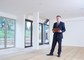 Real estate agent in empty home