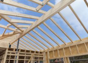 Roof framing against a blue sky
