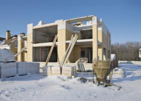 Snowy home construction site