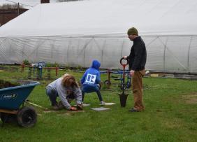 Lansing, MI, Pop-Up Park - realtors planting a tree in the park