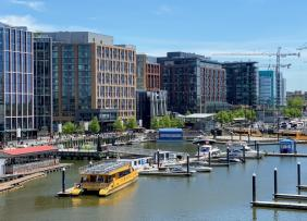 View of the DC Wharf showing buildings and a marina on the Anacostia River