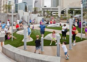 Romare Bearden Park in Charlotte, NC featuring a whimsical splashpad and interactive art forms