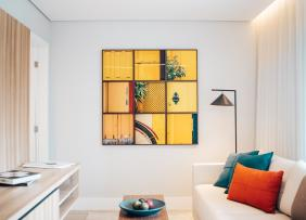 A stylish living room staged using bright accents